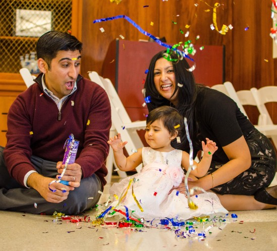 young family with confetti for girls first birthday